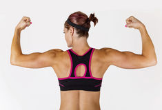 strong-beautiful-fitness-woman-flexing-her-arm-muscles-muscular-biceps-view-behind-to-show-ripped-back-arms-53166851
